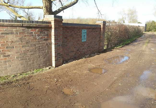 A Front garden wall repaired and extended using a matching cassandra brick at a job in Edingley, Nottingham