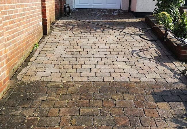 Driveway clean in Bakersfield, Nottingham. Photo taken halfway though to illustrate the difference before/after cleaning.