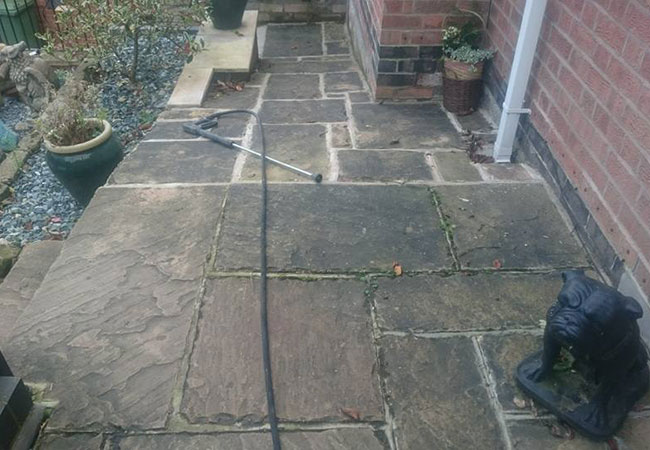 Indian sandstone path cleaning in Lowdham, Nottingham (before)