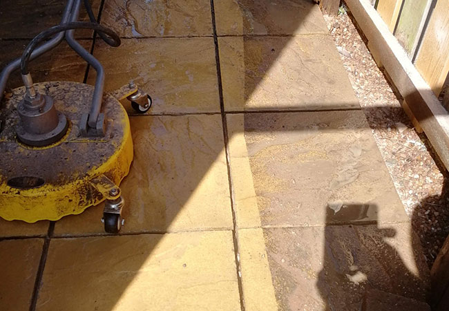 Patio raked out, cleaned and repointed in Arnold, Nottingham (during)