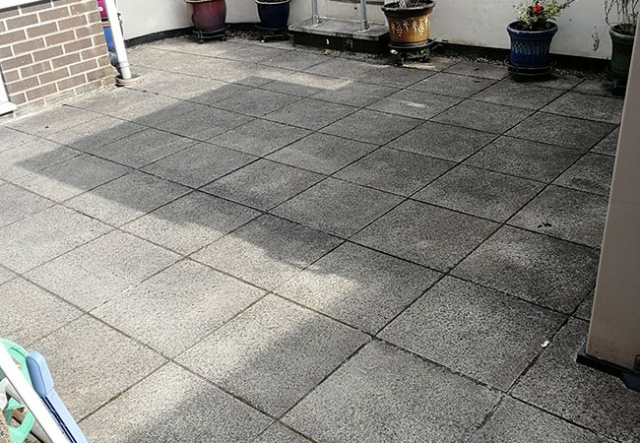 Patio raked out, cleaned and repointed in Arnold, Nottingham (before)