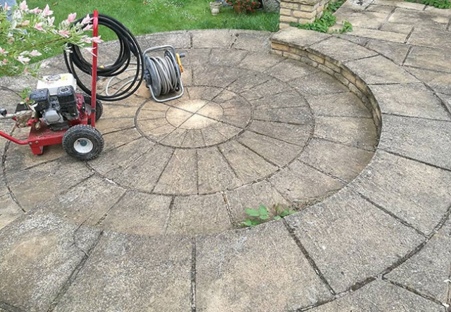 A Patio circle we repaired, cleaned and repointed on a job in Keyworth, Nottingham (before)