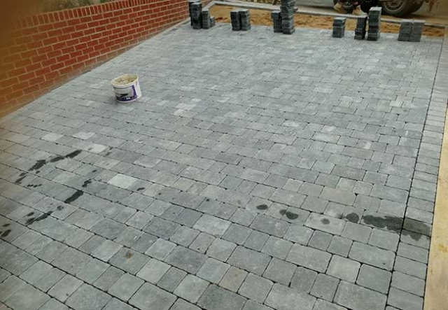 A concrete driveway uplifted, groundwork prepared and a bradstone woburn rumbled graphite pavior in three different sizes laid at a job in Carlton, Nottingham