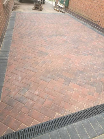 A small area block paved using Charcoal paviors around the edges and a brindle block paving infill on a job in Colwick, Nottingham