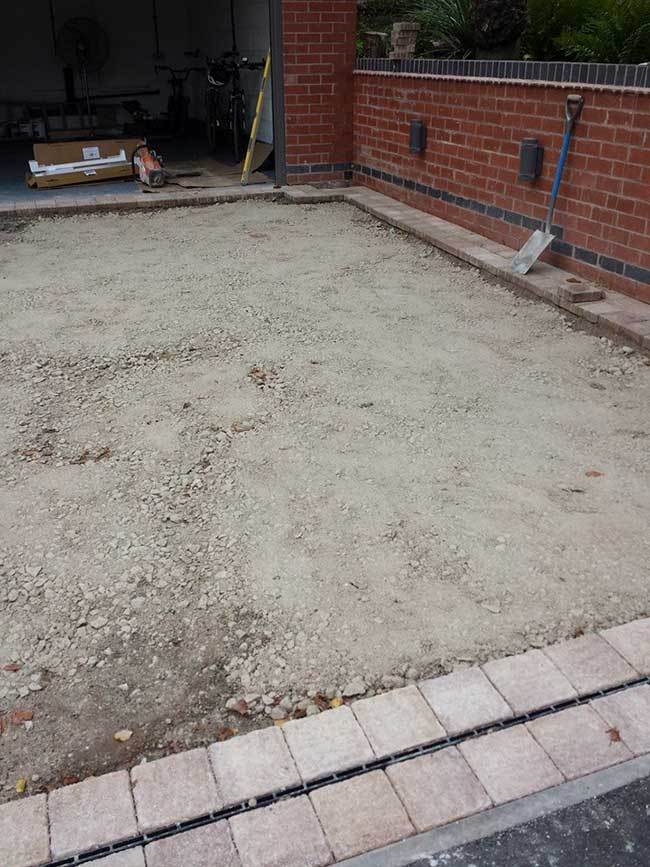 A driveway installed in front of a garage (that we also built) in Woodthorpe, Nottingham.