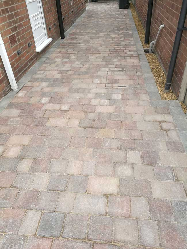A concrete driveway uplifted, groundwork prepared then a marshalls tegula pavers, mixed harvest and traditional colours used to create this driveway in Hucknall, Nottingham.