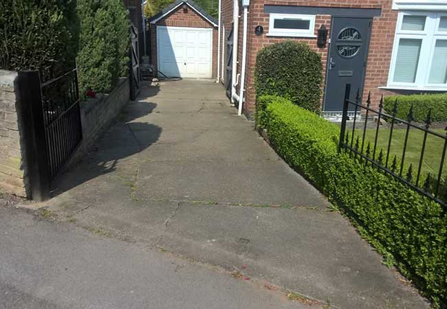 A concrete driveway we removed with groundwork prepared. A charcoal edging pavoir infill used with a brindle block paving on a job undertaken in Hucknall, Nottingham