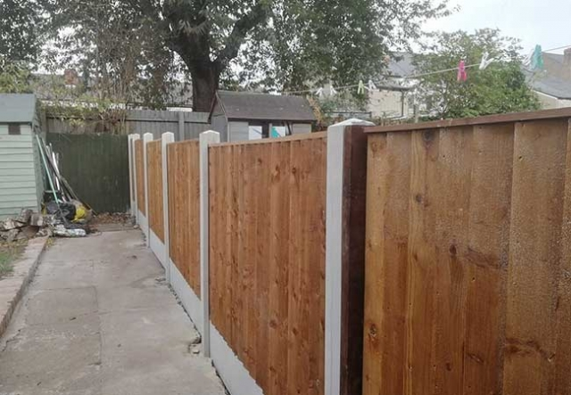 A fence we installed at Netherfield, Nottingham using concrete post and gravel boards with close boarded panels for a job.