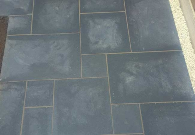 A black limestone patio we layed at a job we completed in Basford, Nottingham