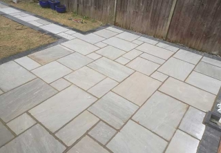 A rear patio we created in Radcliffe on Trent (Nottinghamshire) using a charcoal pavior border with a kandla grey indian sandstone. We also turfed the grassed area.