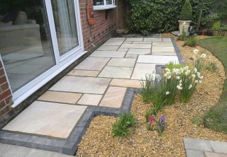 A rear patio we layed using a fossil buff indian sanstone at a job in Hucknall, Nottingham