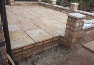 A patio we layed in Gedling, Nottingham once we had built the retaining wall, steps and installed the fence