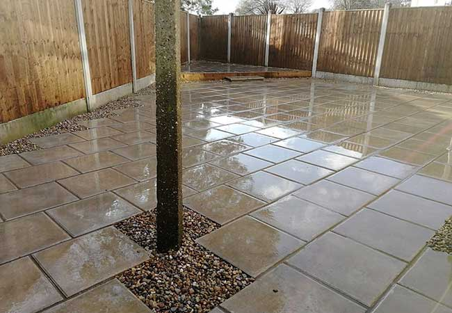 A rear patio we installed using plain grey 450x450 slabs for a job in Carlton, Nottingham