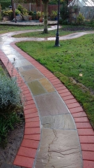 A path we created at a job in Edwalton, Nottingham using a red pavior for the edging and a multi buff indian sanstone for the infill of the path