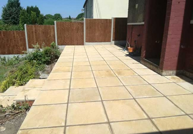 A rear patio we created using simple 600x600mm riven concrete slabs for a job in Ilkeston, Derby